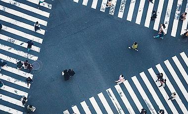 People walking on crossing city street crosswalk top view Japan