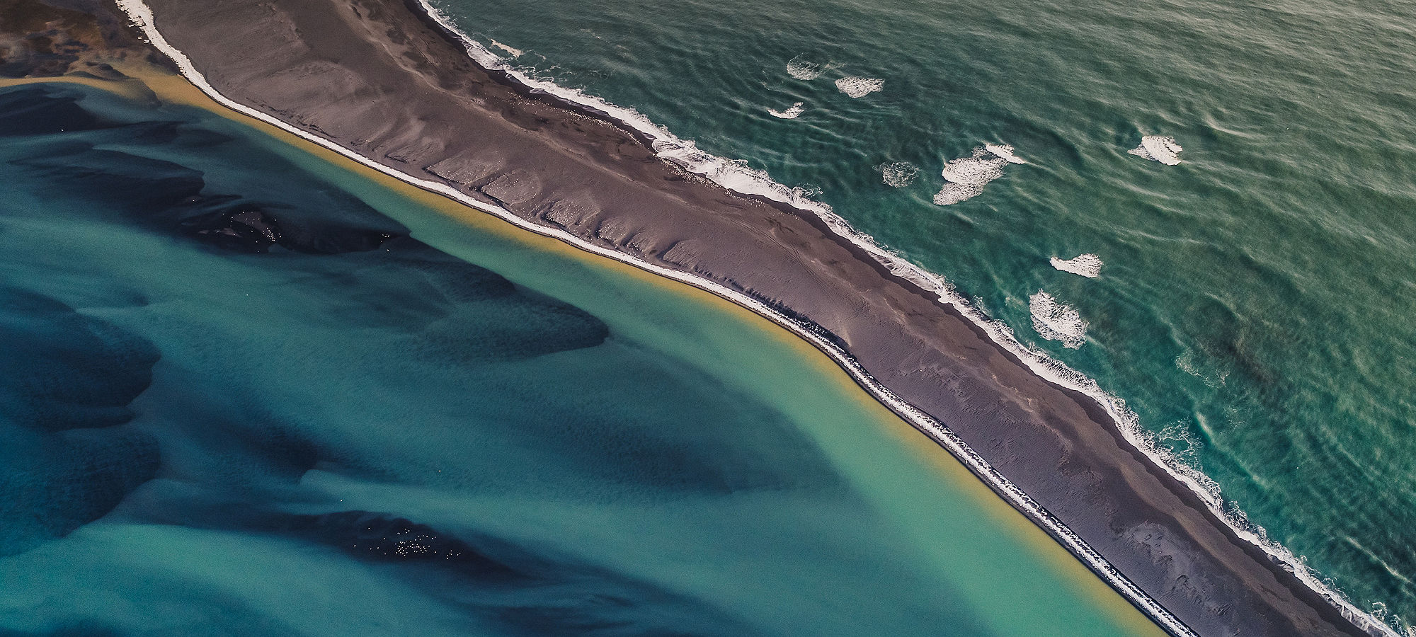 aerial-view-of-thin-barrier-island-with-water-on-each-side