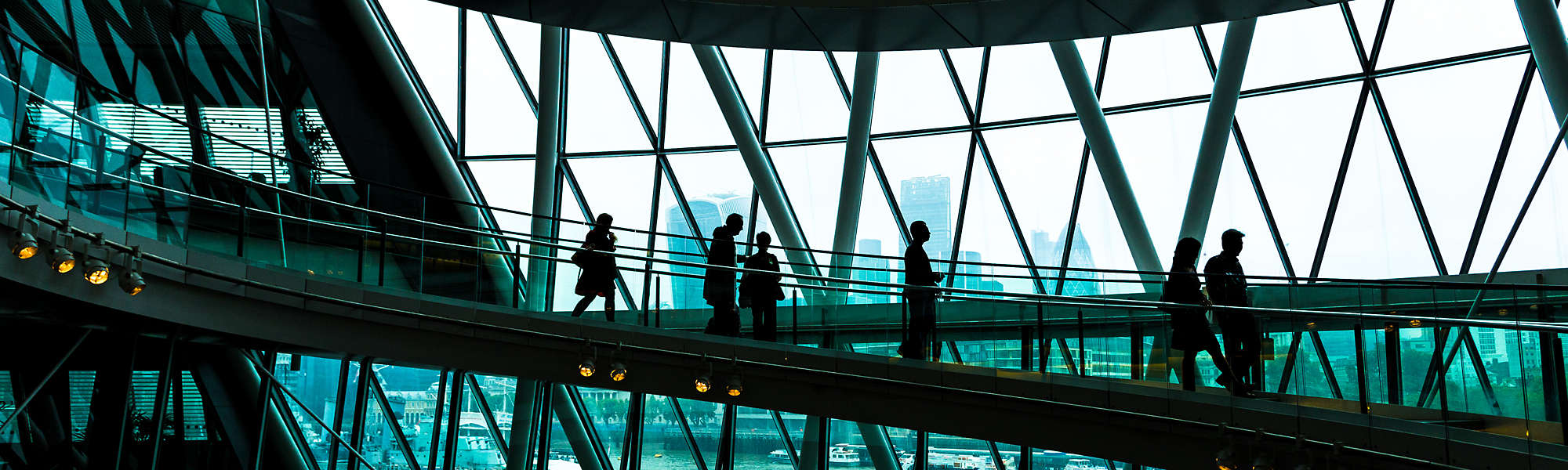 Abstract modern architecture and silhouettes of people on spiral staircase London England