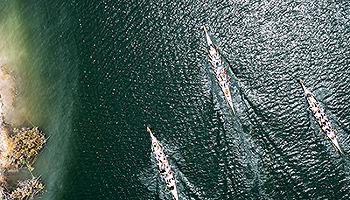 aerila-of-three-row-teams-on-river