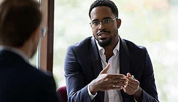 Male employee talking colleague
