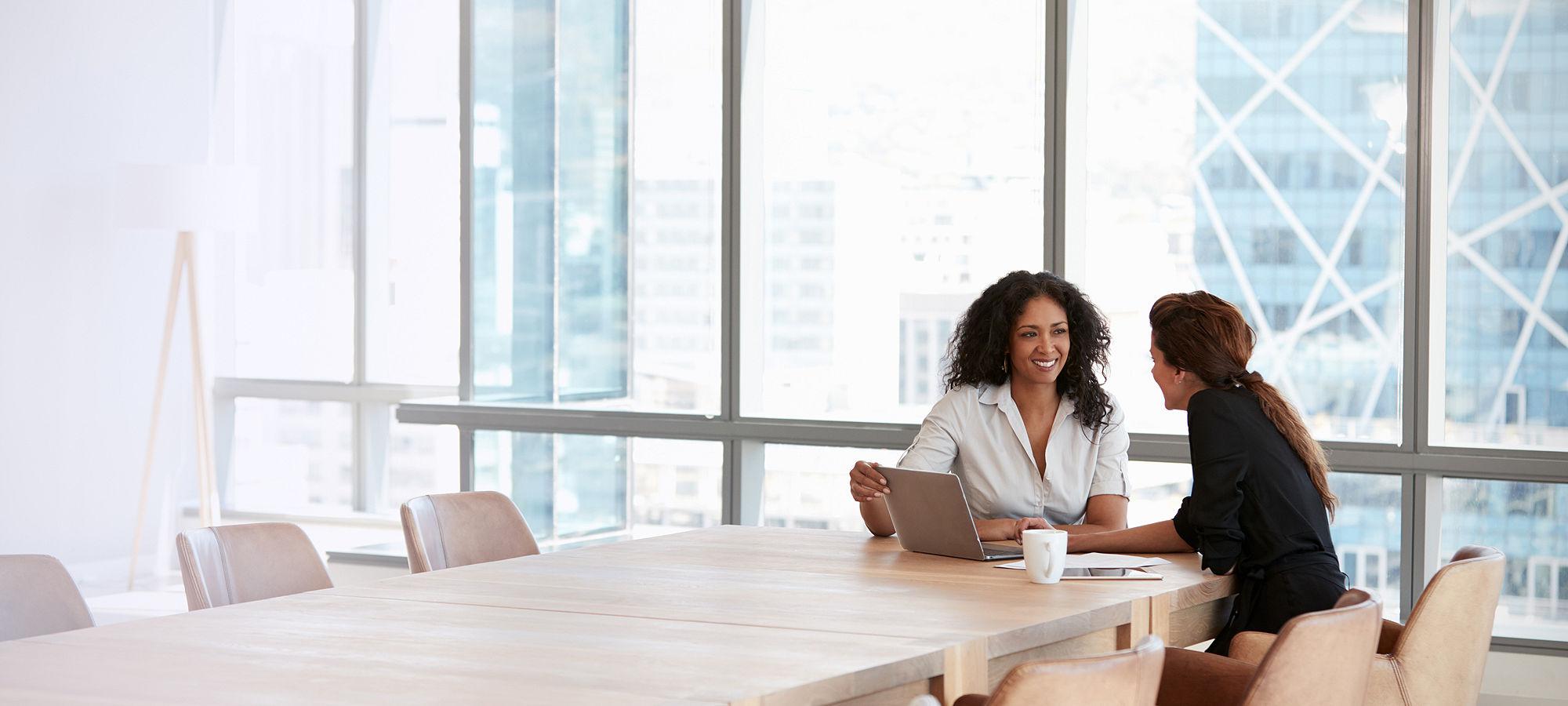Businesswomen laptop boardroom meeting