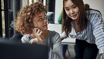 Businesswomen working together desk