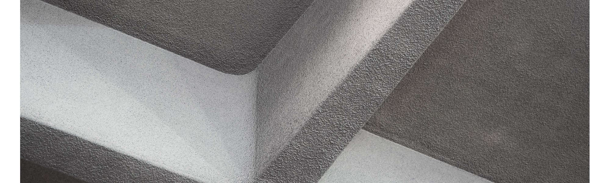 Low angle view of concrete cross on ceiling