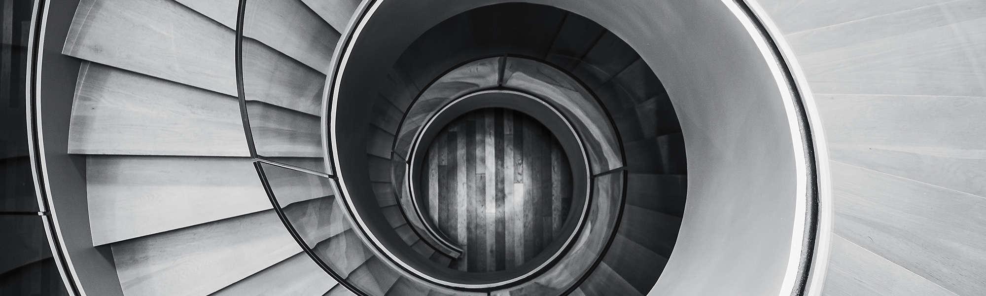 monochrome spiral staircase banner