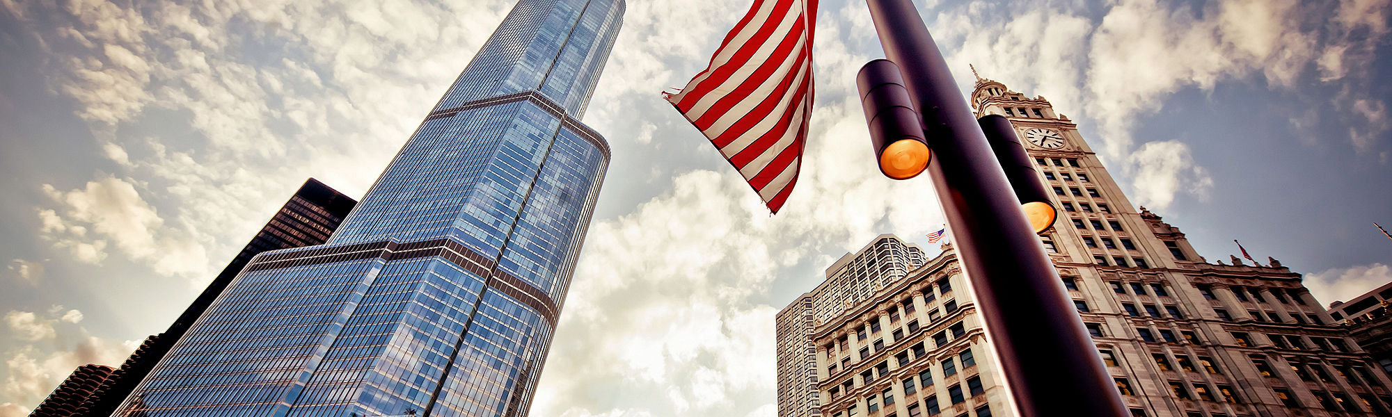 American flag over skyscrapers