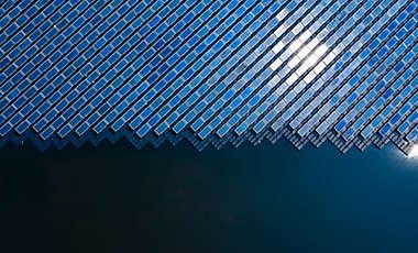 Aerial solar farm pond rows