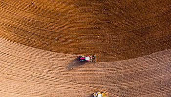 Aerial view with drone of tractor plowing the land in the countryside Spain