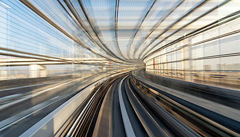 Motion blur of train moving inside tunnel in Tokyo, Japan Banner