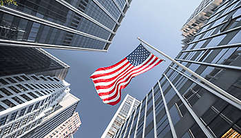 UUS flag and contemporary glass architecture, Financial District, New York