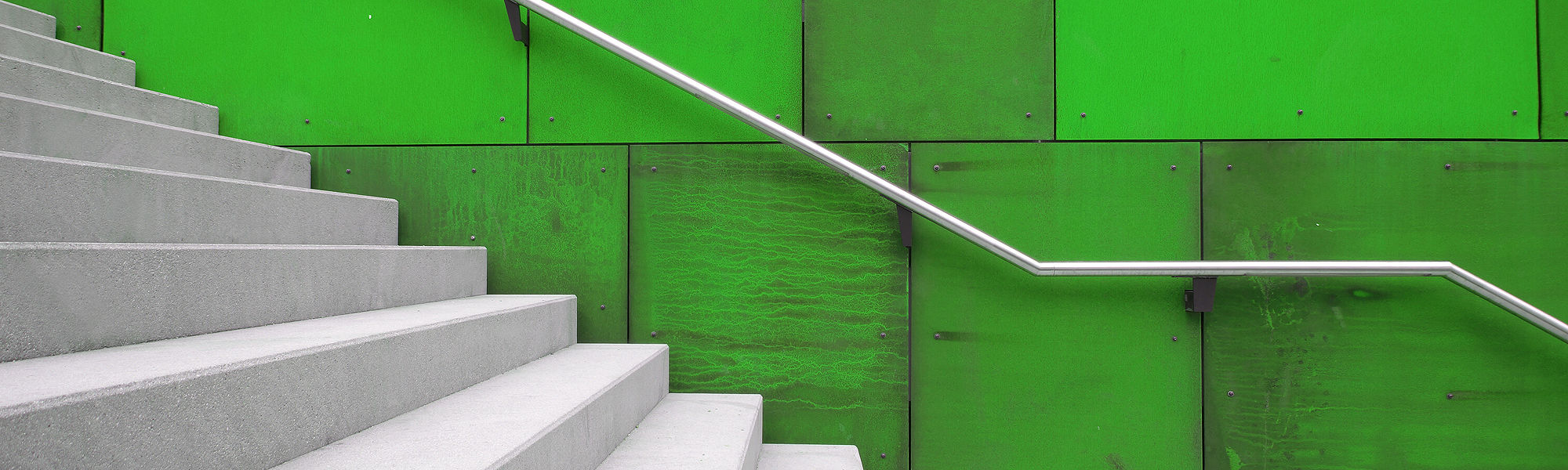 White staircase with green wall